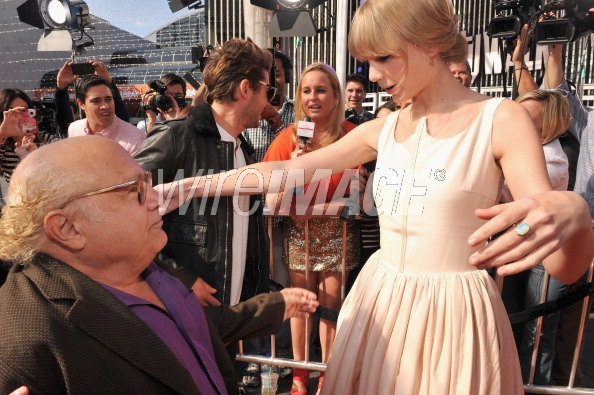 Source http://www.wireimage.com/celebrity-pictures/Actors-Danny-DeVito-and-Taylor-Swift-arrive-at-the-Dr-Seuss-The-Lorax/139360633