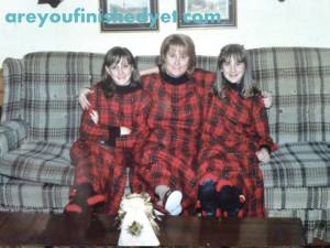 The welcoming committee: Kelly, her mom, and her sister. It's a plaid party, and Santa's invited. Don't forget the egg nog.